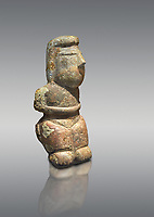 Middle Neolithic quartzose sandstone statue of a goddess from the archaeological site of Cott'e Baccas in Segarlu, Sardinia,. Museo archeologico nazionale, Cagliari, Italy. (National Archaeological Museum) - Grey Background