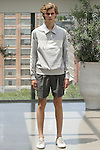 Model Mats poses in an outfit from the Deveaux Spring Summer 2017 collection on July 13 2016, during New York Fashion Week Men's Spring Summer 2017.
