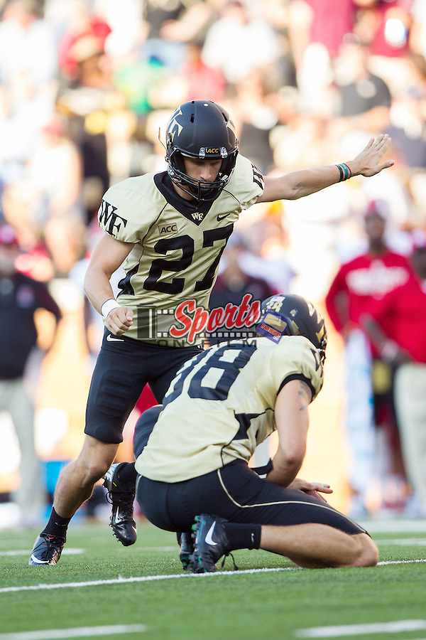 Chad Hedlund (27) of the Wake Forest Demon Deacons attempts a field goal during second half action against the North Carolina State Wolfpack at BB&T Field on October 5, 2013 in Winston-Salem, North Carolina.  The Demon Deacons defeated the Wolfpack 28-13.    (Brian Westerholt/Sports On Film)