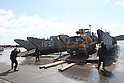 OSHIMA, Japan - A U.S. Navy sailor directs a Japanese utility repair vehicle off a U.S. Navy landing craft docked here, March 27. The 31st Marine Expeditionary Unit and Amphibious Squadron 11 picked up Japanese utility repair vehicles from the port in Kessenuma and delivered food, water, comfort items and the vehicles to residents on this isolated island. The island of Oshima has been cut off from the mainland since the earthquake and tsunami March 11. The operation demonstrated the expeditionary capabilities in ship-to-shore amphibious operations. Marines and Sailors of the 31st MEU are conducting humanitarian aid and disaster relief missions in northeast Japan assisting the Japanese Self Defense Forces in their ongoing operations. (Photo by USMC/AFLO) [0006]