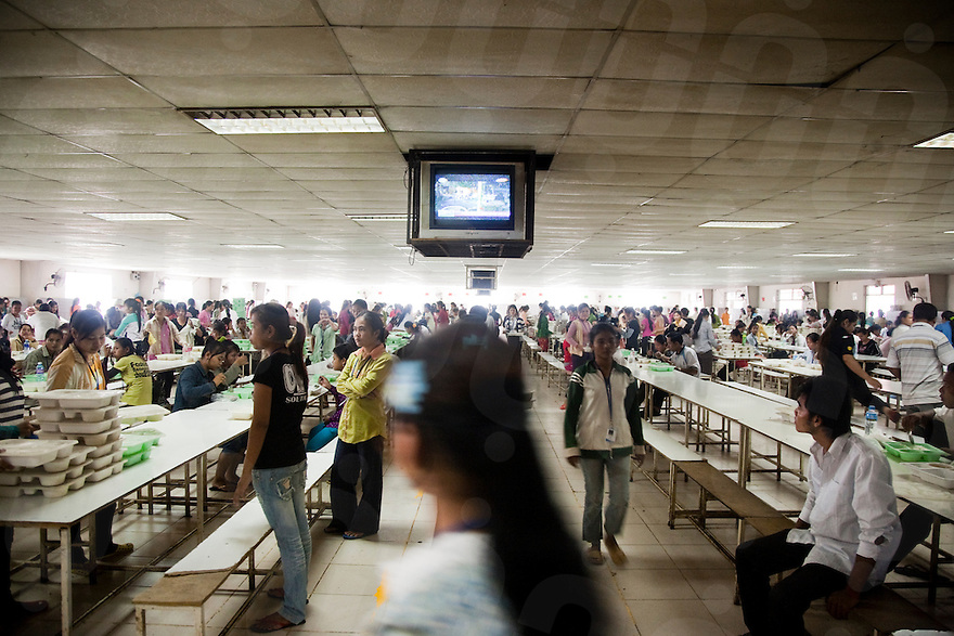 July 15, 2009 - Phnom Penh, Cambodia. Lunch break for garment factory workers in the factory canteen. © Nicolas Axelrod / Ruom