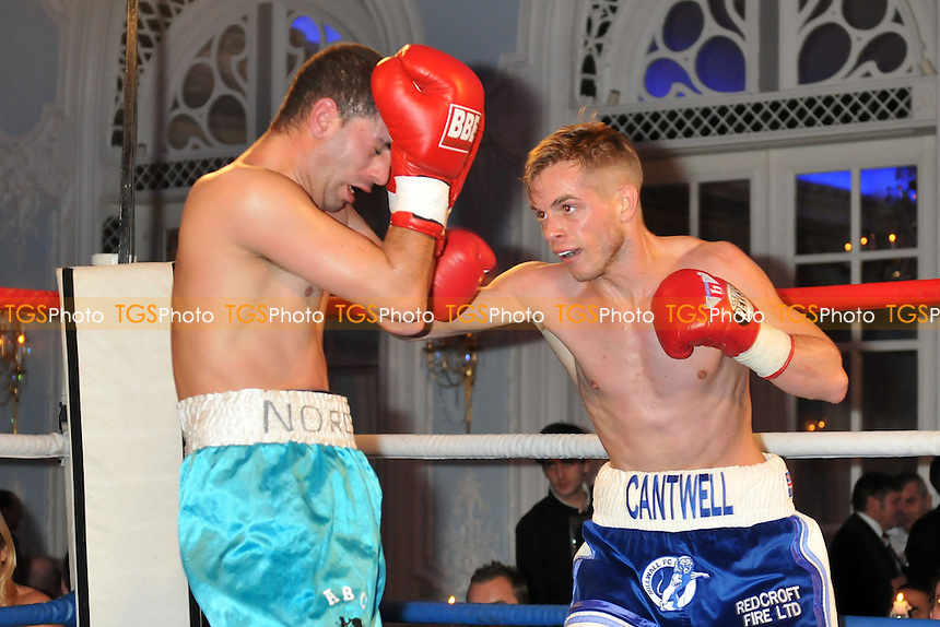 Sam Cantwell (blue shorts) defeats Narredine Dahou in a Super-Flyweight boxing contest at the Savoy Hotel, The Strand, London - 21/11/13 - MANDATORY CREDIT: Philip Sharkey/TGSPHOTO - Self billing applies where appropriate - 0845 094 6026 - contact@tgsphoto.co.uk - NO UNPAID USE