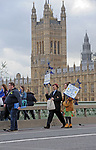 "Protestors cross  Westminster Bridge at the end of  the ""Put it to the People"" rally which made it's way through central London today. Demonstrators from across the country gathered to call for a second referendum on Brexit and to march through the UK capital finishing with speeches in Parliament Square opposite the Houses of Parliament in Westminster."