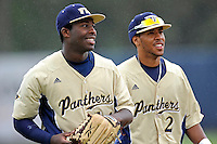 4 March 2012:  FIU outfielder Jabari Henry (14) and shortstop Julius Gaines (2) enjoy a light moment prior to the game as the FIU Golden Panthers defeated the Brown University Bears, 8-3, at University Park Stadium in Miami, Florida.