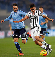 Calcio, Serie A: Lazio vs Juventus. Roma, stadio Olimpico, 4 dicembre 2015.<br /> Juventus&rsquo; Paulo Dybala, right,is chased by Lazio&rsquo;s Santiago Gentiletti during the Italian Serie A football match between Lazio and Juventus at Rome's Olympic stadium, 4 December 2015.<br /> UPDATE IMAGES PRESS/Riccardo De Luca