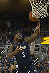 Akron forward Daniel Utomi (3) is fouled as he shoots a layup against Nevada in the second half of an NCAA college basketball game in Reno, Nev., Saturday, Dec. 22, 2018. (AP Photo/Tom R. Smedes)