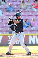 Jose Urena #21 of the Eugene Emeralds bats against the Salem-Keizer Volcanoes at Volcanoes Stadium on July 27, 2014 in Keizer, Oregon. Salem-Keizer defeated Eugene, 9-1. (Larry Goren/Four Seam Images)