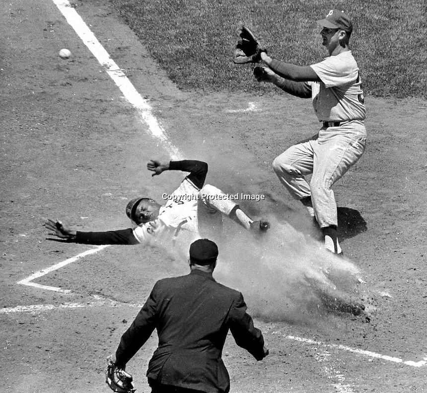 San Francisco Giants Tito Fuentes slides safe into home against Philadelphia Philly pitcher.(july 24,1966 photo/Ron Riesterer)