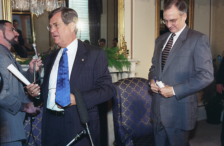 12/3/98.LOTT/LIVINGSTON MEETING--Senate Majority Leader Trent Lott, R-Miss., and House Speaker-elect Bob Livingston, R-La., pause after a photo-opp of their meeting in Lott's office. Lott is removing a CNN microphone cord as he answers a question..CONGRESSIONAL QUARTERLY PHOTO BY SCOTT J. FERRELL