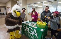 NWA Democrat-Gazette/BEN GOFF @NWABENGOFF<br /> Eddie the Eagle and SAGA representatives hand out stress balls Wednesday, Dec. 5, 2018, during the Student Ambassadors and Government Association's finals stress relief party in Burns Hall at Northwest Arkansas Community College in Bentonville. Representatives from SAGA were offering snacks, coffee, hot chocolate, stress balls, and chair massages Tuesday and Wednesday as students prepare for their final exams next week.