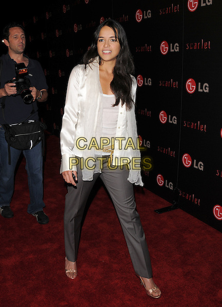 MICHELLE RODRIGUEZ.The LG Electronics launch of The Scarlet HD TV Series held at The Pacific Design Center in Beverly Hills, California, USA..April 28th, 2008                                           .full length white shirt blouse sheer scarf grey gray trousers slacks gold shoes .CAP/DVS.©Debbie VanStory/Capital Pictures.