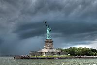 Statue of Libery under a dark menacing sky