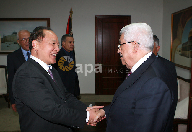 Palestinian president Mahmoud Abbas, meets with Chinese envoy to the peace process in the West bank city of Ramallah, on May. 07, 2012.  Photo by Thaer Ganaim