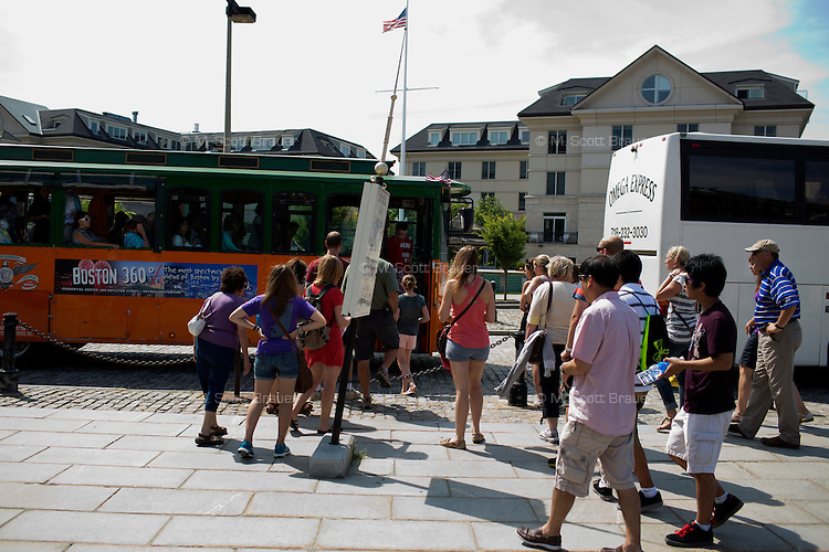 Tourists get onto a sightseeing bus at the Charlestown Navy Yard in Charlestown, Boston, Massachusetts, USA.