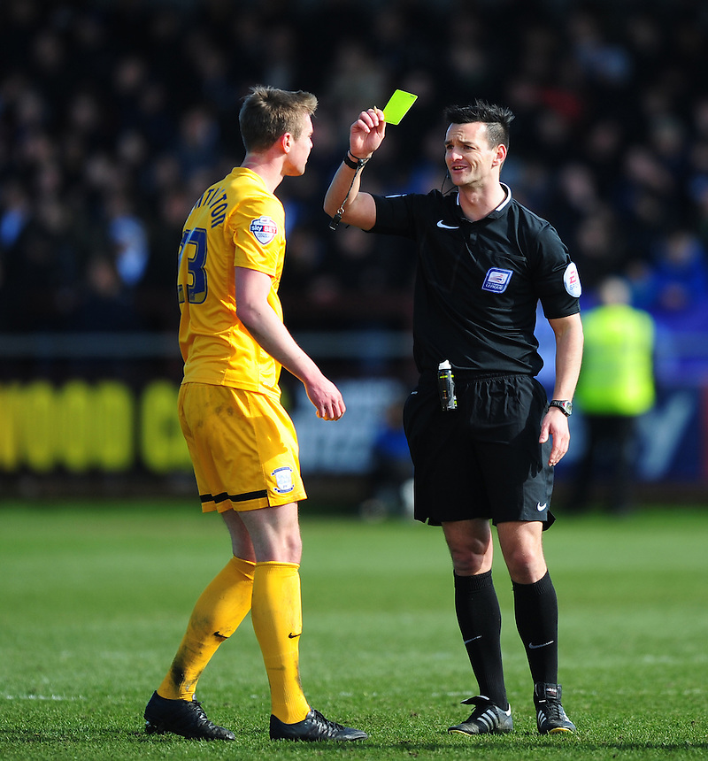 Preston North End's Paul Huntington is shown a yellow card by Referee Andy Madley <br /> <br /> Photographer Chris Vaughan/CameraSport<br /> <br /> Football - The Football League Sky Bet League One -  Fleetwood Town v Preston North End - Sunday 29th March 2015 - Highbury Stadium - Fleetwood<br /> <br /> &copy; CameraSport - 43 Linden Ave. Countesthorpe. Leicester. England. LE8 5PG - Tel: +44 (0) 116 277 4147 - admin@camerasport.com - www.camerasport.com