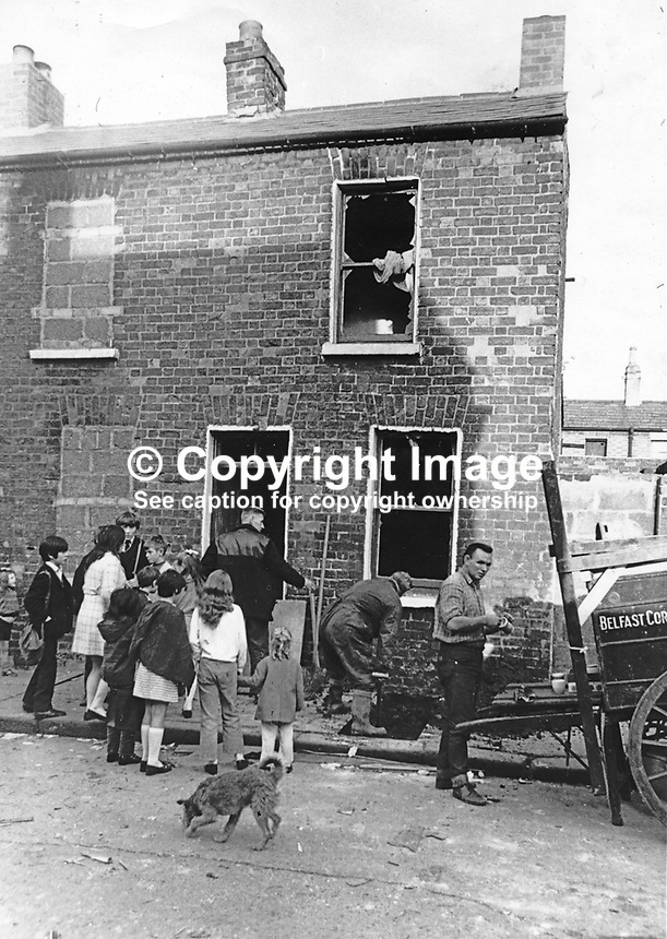 Belfast Corporation workmen at the house in Merrion Street, Lower Falls, Belfast, N Ireland, where two members of the Official IRA, OIRA, Gerard O'Hare, 17 years, and Rose Curry, 18 years, both from West Belfast, died when the bomb they were working on exploded prematurely. 23rd September 1971. 19710920328,<br />