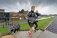 George Byers (C) and Mike van der Hoorn (R) lead their team mates onto the pitch during the Swansea City Training Session at The Fairwood Training Ground, in Swansea, Wales, UK. Wednesday 06 March 2019