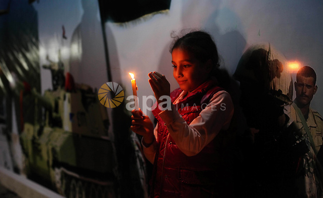 Palestinians light candles to mourn victims of the Egyptian soldiers killed in a suicide attack in Sinai on Friday, at the Egyptian community headquarter in Gaza city October 28, 2014. Cairo shut the vital crossing following two terrorist attacks in Egypt's restive Sinai Peninsula that left at least 33 Egyptian security personnel dead on October 24. Egyptian authorities also declared a state of emergency in the north and center of Sinai for three months. Photo by Ashraf Amra