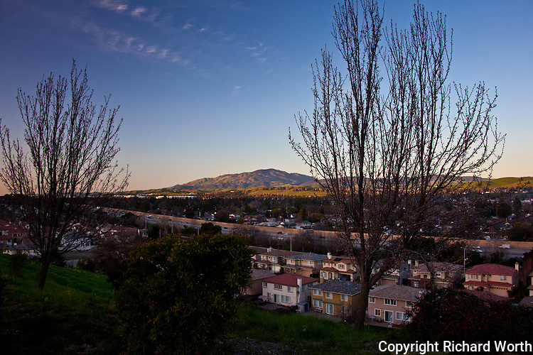 Homes and freeway traffic of the San Ramon Valley with Mount Diablo rising in the distance.