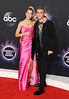 LOS ANGELES, CA - NOVEMBER 24: Anwar Hadid (L) and Dua Lipa attend the 2019 American Music Awards at Microsoft Theater on November 24, 2019 in Los Angeles, California, USA.<br /> CAP/ROT/TM<br /> ©TM/ROT/Capital Pictures