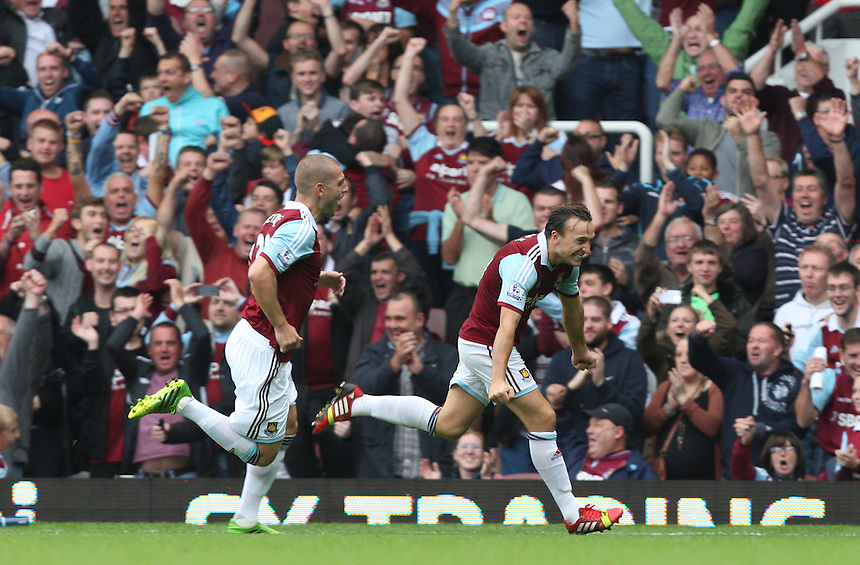 West Ham United's Mark Noble celebrates his goal from the penalty spot <br /> <br /> Photo by Kieran Galvin/CameraSport<br /> <br /> Football - Barclays Premiership - West Ham United v Everton - Saturday 21st September 2013 - Boleyn Ground - London<br /> <br /> &copy; CameraSport - 43 Linden Ave. Countesthorpe. Leicester. England. LE8 5PG - Tel: +44 (0) 116 277 4147 - admin@camerasport.com - www.camerasport.com