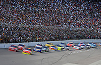 Nov. 8, 2009; Fort Worth, TX, USA; NASCAR Sprint Cup Series drivers Jeff Gordon (24) and Kasey Kahne (9) lead the field during the Dickies 500 at the Texas Motor Speedway. Mandatory Credit: Mark J. Rebilas-