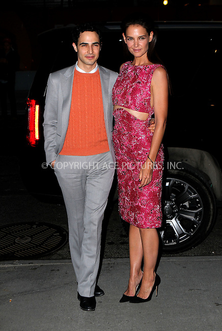 WWW.ACEPIXS.COM<br /> <br /> March 30 2015, New York City<br /> <br /> Actress Katie Holmes (L) and designer Zac Posen arriving at the 'Woman In Gold' New York premiere at Museum of Modern Art on March 30, 2015 in New York City. <br /> <br /> By Line: Nancy Rivera/ACE Pictures<br /> <br /> <br /> ACE Pictures, Inc.<br /> tel: 646 769 0430<br /> Email: info@acepixs.com<br /> www.acepixs.com
