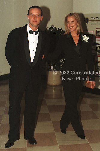 Lauren Hutton and Luca Babini arrive at The White House in Washington, D.C. for a dinner in honor of the National Medal of Arts recipients on January 9, 1997..Credit: Ron Sachs / CNP