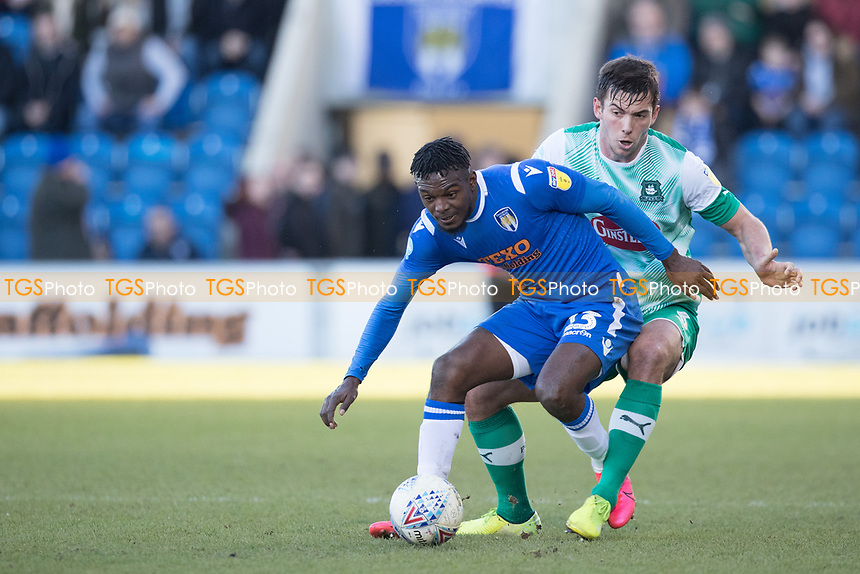Theo Robinson of Colchester United effectively shields the ball from Niall Canavan of Plymouth Argyle during Colchester United vs Plymouth Argyle, Sky Bet EFL League 2 Football at the JobServe Community Stadium on 8th February 2020