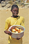 Local Boy On Nkhata Bay Beach Selling Sandwiches