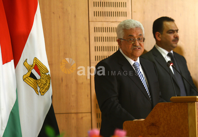 Palestinian President Mahmoud Abbas (Abu Mazen) delivers a speech during the signing of reconciliation agreement in Cairo, Egypt on May 4,2011. Fatah and Hamas officials lead a ceremony celebrating the signing of a reconciliation deal intended to repair ties between the rival movements. Photo by Ashraf Amra