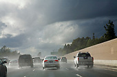 Cars driving in rainstorm on 101 Freeway. Los Angeles, California, USA