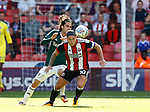 Jota of Brentford and Billy Sharp of Sheffield Utd during the English Championship League match at Bramall Lane Stadium, Sheffield. Picture date: August 5th 2017. Pic credit should read: Simon Bellis/Sportimage