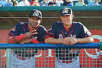 Peoria Chiefs catcher Luis Cruz (30) and pitcher Jhonny Polanco (39) in the dugout before a game against the Lansing Lugnuts on June 6, 2015 at Cooley Law School Stadium in Lansing, Michigan.  Lansing defeated Peoria 6-2.  (Mike Janes/Four Seam Images)