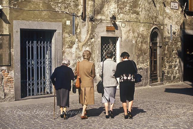 Group of elderly women walking. Orvieto, Italy