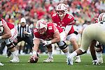 Wisconsin Badgers quarterback Alex Hornibrook (12) lines up under center Tyler Biadasz (61) during an NCAA College Football Big Ten Conference game against the Purdue Boilermakers Saturday, October 14, 2017, in Madison, Wis. The Badgers won 17-9. (Photo by David Stluka)