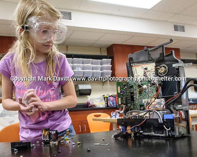 """Southeast Polk hosted Camp Invention in partnership with the National Inventors Hall of Fame. It gives students an opportunity to get creative and inventive with science, technology and engineering. Lucy Lard assesses parts for """"a robot that could talk to me."""""""