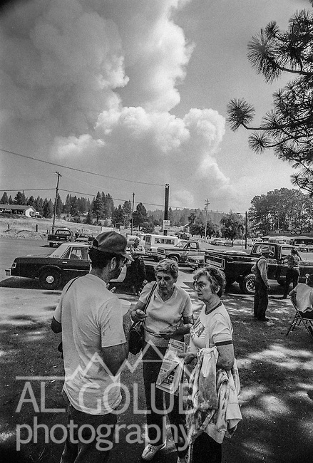September 4, 1987 Greeley Hill, California --Stanislaus Complex Fire  -- Giant column of smoke can be seen easily in Greeley Hill. The Stanislaus Complex Fire consumed 28 structures and 145,980 acres.  One US Forest Service firefighter, David Ross Erickson, died from a tree-felling accident.