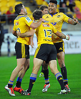 James Marshall (left) and Ardie Savea congratulate Conrad Smith on his try during the Super Rugby match between the Hurricanes and Sharks at Westpac Stadium, Wellington, New Zealand on Saturday, 9 May 2015. Photo: Dave Lintott / lintottphoto.co.nz