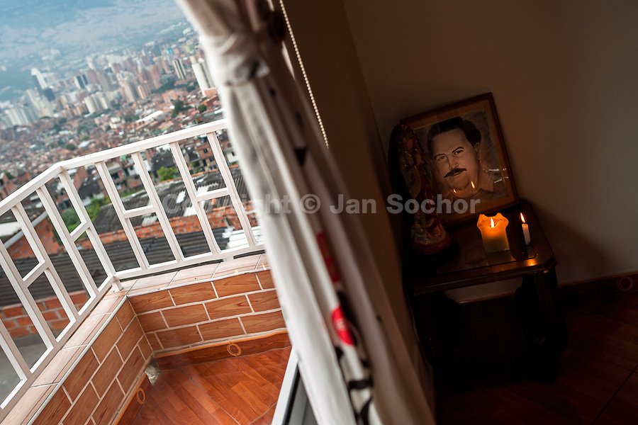 "An altar in honor of the drug lord Pablo Escobar is seen placed in the living room corner of a house in the Pablo Escobar neighborhood, Medellín, Colombia, 30 November 2017. Twenty five years after Pablo Escobar's death, the legacy of the Medellín Cartel leader is alive and flourishing. Although many Colombians who lived through the decades of drug wars, assassinations, kidnappings, reject Pablo Escobar's cult and his celebrity status, there is a significant number of Colombians who admire him, worshipping the questionable ""Robin Hood"" image he had. Moreover, in the recent years, the popular ""Narcos"" TV series has inspired thousands of tourists to visit Medellín, creating a booming business for many but causing a controversial rise of narco-tourism."