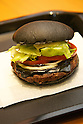 The &quot;Kuro Diamond&quot; burger at Burger King restaurant on September 19, 2014 in Tokyo, Japan. Burger King launches to its menu two kinds of black burgers &quot;Kuro Diamond&quot; and &quot;Kuro Pearl&quot; which contains black buns and black cheese made from bamboo charcoal, garlic sauce made with squid ink and beef patties made with black pepper all in black color starting on Friday, September 19 for a limit period. The Kuro Diamond priced at 690 JPY <br /> (6.35 USD) and the Kuro Pearl which cost at 480 JPY (4.42 USD). The last year Burger King included the &quot;Ninja Burger&quot; similar black burger on its Japanese menu. (Photo by Rodrigo Reyes Marin/AFLO)