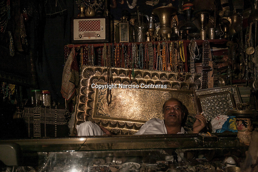 Sunday 12 July, 2015: A seller is seen inside an antiquities-shop in the market place of the Old City of Sana'a, a 2,500-year-old cultural heritage site endangered after a fighter jet of the Saudi-led coalition bombed and destroyed a line of residential tower-houses killing 4 residents and reducing to rubble the historial site. (Photo/Narciso Contreras)