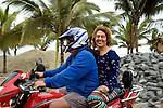 Ecuadoran couple on motor bike in Mata, Ecuador