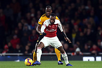 Alexandre Lacazette of Arsenal and Willy Boly of Wolves during Arsenal vs Wolverhampton Wanderers, Premier League Football at the Emirates Stadium on 11th November 2018