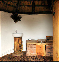 BNPS.co.uk (01202 558833)<br /> Pic: UpcottRoundhouse/BNPS<br /> <br /> Yabba-dabba-doo...<br /> <br /> Back to basics bathroom.<br /> <br /> A farmer has painstakingly recreated an Iron Age roundhouse to enable holidaymakers to release their inner Flintstone in the heart of the Devon countryside.<br /> <br /> Charles Cole has gone back over 2000 years to offer a back to basic's experience including a stone hearth fire, rudimentary plumbing, composting toilet and a six ton thatched roof to keep out the wind and rain.<br /> <br /> The amazing structure has been completely hand built by Charles and his family from materials sourced from their own farm and they have just opened up for bookings at &pound;170 a night..animal skins are optional.
