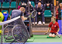 December 20, 2014, Rotterdam, Topsport Centrum, Lotto NK Tennis, Mens doubles wheelchair final,  Maikel Scheffers runs into the net<br /> Photo: Tennisimages/Henk Koster
