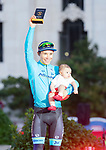 Miguel Angel Lopez Moreno and his baby receive the 'supercombativo' mallot on the podium of the last Stage of La Vuelta 2019 . September 15, 2019. (ALTERPHOTOS/Francis Gonzalez)