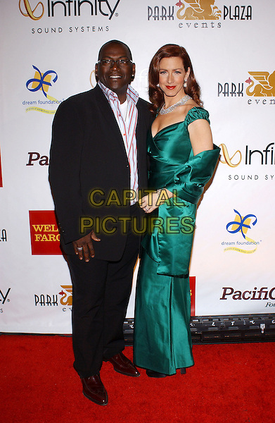 RANDY JACKSON & JOELY FISHER.3rd Annual Cabaret of Dreams to benefit the Dream Foundation held at the Park Plaza Hotel..November 4th, 2004.full length, balck suit, green silk satin dress.www.capitalpictures.com.sales@capitalpictures.com.© Capital Pictures.