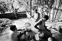 This family of four runs a coca farm. They with the help of the whole family and with some neighbors plant, harvest and make the crude coca paste ? from which cocaine is made. They make around $1,000 (US dollars) a year after expenses. Some of their major concerns are government fumigations, police raids and both guerrilla and paramilitary troubles..Putumayo, Colombia 2003.<br />