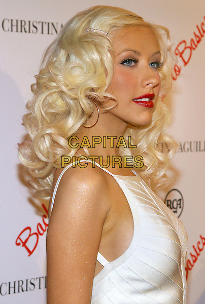 """CHRISTINA AGUILERA.Celebrates the launch of her new album """"Back to Basics"""",.New York City, New York, USA,.15 August 2006..half length hoop earrings red lipstick cream white dress  hair slide grip clip diamante shoulder .Ref: ADM/JL.www.capitalpictures.com.sales@capitalpictures.com.©Jackson Lee/AdMedia/Capital Pictures."""